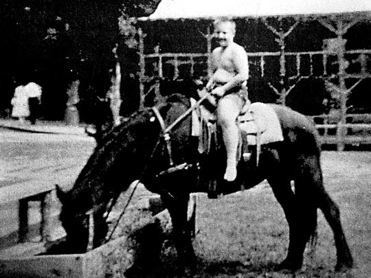 Charles Tilton Jr.'s steed takes a water break at Mountain Village. The Martin House is in the background.
