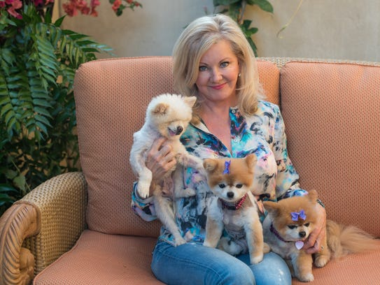 Sandy Giles with her adopted pets.