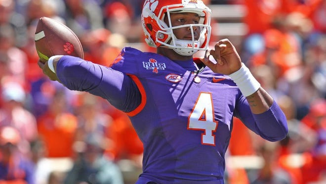 Clemson's Deshaun Watson (4) throws a 61-yard touchdown pass to Clemson's Ray-Ray McCloud (34) during the spring game in Memorial Stadium in Clemson.