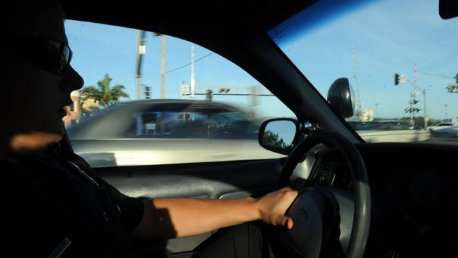 CHUCK KIRMAN/THE STAR Senior Officer Brandon Ordelheide of the Oxnard Police Department travels on Oxnard Boulevard looking for people talking on a cellphone or texting. The California Highway Patrol also joined in the operation that targeted distracted drivers.