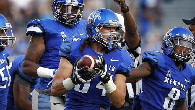 Memphis' Jackson Dillon (middle) celebrates after recovering a Missouri State fumble during the first quarter Sept. 5, 2015, at Liberty Bowl Memorial Stadium.