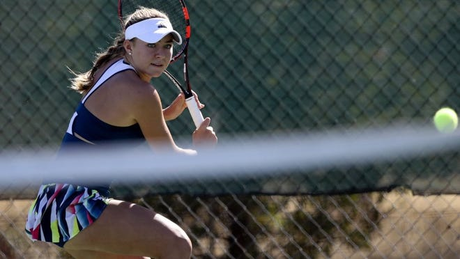 McKenzie prepares to hit a backhand in her singles match Thursday.