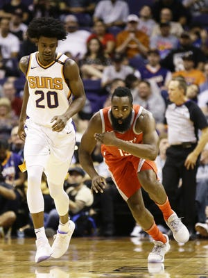 Houston Rockets James Harden reacts after making a 3-pointer against Phoenix Suns Josh Jackson in the first half on Nov. 16, 2017 at Taking Stick Resort Arena in Phoenix, Ariz. The Rockets scored 90 points in the half.