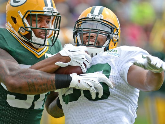 Green Bay Packers wide receiver Ty Montgomery, right,