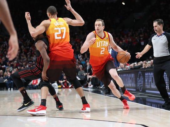 Utah Jazz center Rudy Gobert (27) drives to the basket