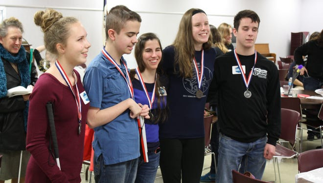 Alyssa Townsend, from left, Mason Armstrong, Annabelle Costanzo, Beth Rouse and Alex Gillaspie receive their awards at the end of the 2015 Iowa Braille Challenge.