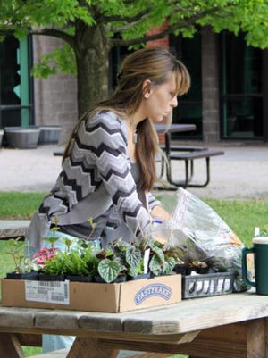 A Master Gardener is shown preparing for a class in the Spring Craft Series. The Series will take place each Monday evening in May beginning at 6:30 p.m.