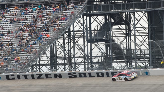 A car races in the NASCAR Sprint Cub Race at the Dover International Speedway.