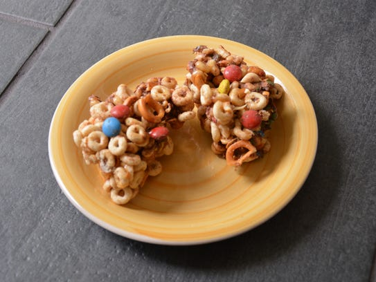 No-Bake Sweet and Salty Cereal Bars have peanuts, candies,