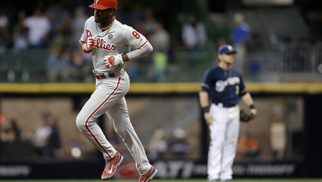 MILWAUKEE, WI - JULY 08: Domonic Brown #9 of the Philadelphia Phillies runs the bases after hitting a solo home run in the top of the third inning against the Milwaukee Brewers at Miller Park on July 08, 2014 in Milwaukee, Wisconsin. (Photo by Mike McGinnis/Getty Images)