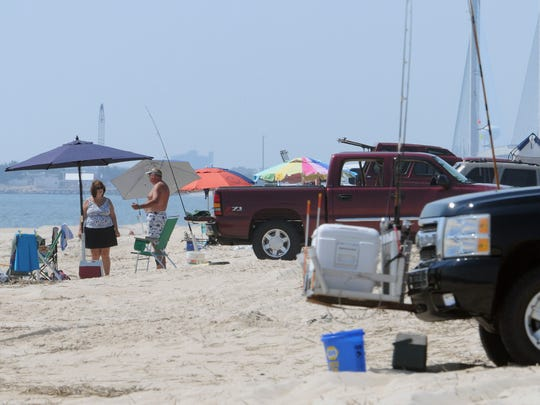 Delaware Seashore State Park attracts surf fishers on July 2, 2012. DNREC has changed its rules for parking on drive-on beaches, requiring people to park in single-file lines.