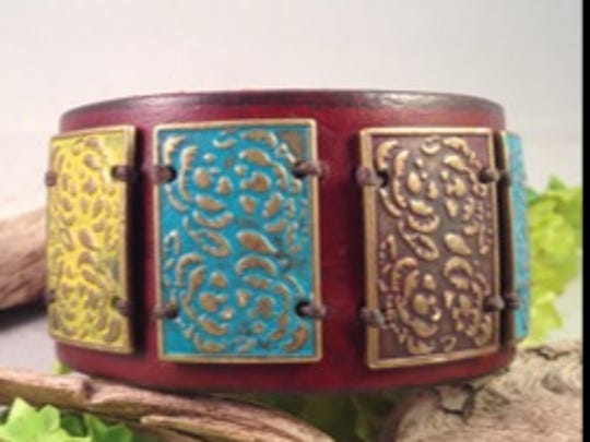 Alyssa Woodard creates one-of-a-kind leather cuffs using upcycled belts and vintage adornments.