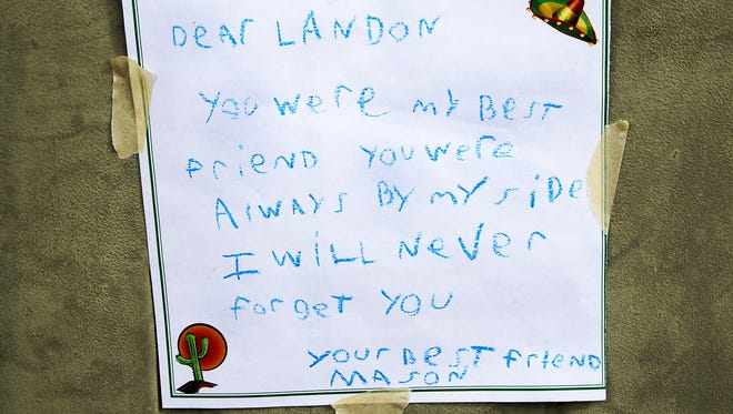 A handwritten note was left at the Phoenix home were 9-year-old Landen Lavarnia was shot on March 20, 2017. He died the next day.