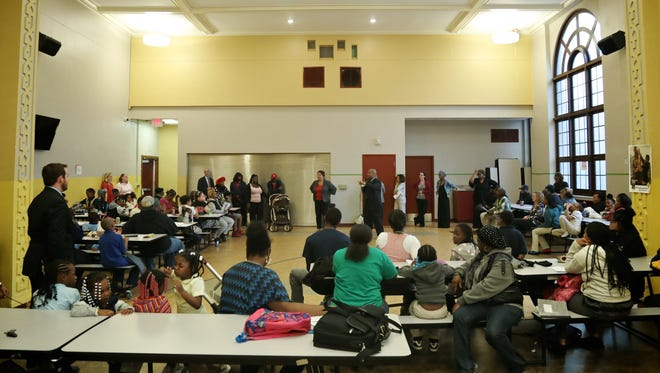 Parents meet with the new principal Evege James III and Education Achievement Authority chancellor Veronica Conforme at Burns Elementary School on Tuesday, October 13, 2015, in Detroit. Some parents are upset because the principal has been replaced.