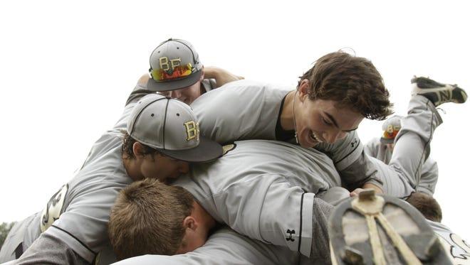 Bishop Foley teammates celebrate their Division 3 final win over Grandville Calvin Christian in Battle Creek on June 15, 2013.