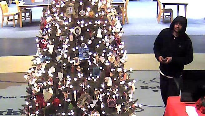 Clarksville Police are looking to identify this man believed to be responsible for stealing a TV and DVD player from the Wings of Love display at the library.