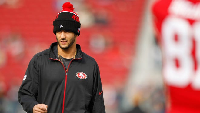 San Francisco 49ers quarterback Colin Kaepernick (7) walks on the field before the start of the game against the St. Louis Rams at Levi's Stadium.
