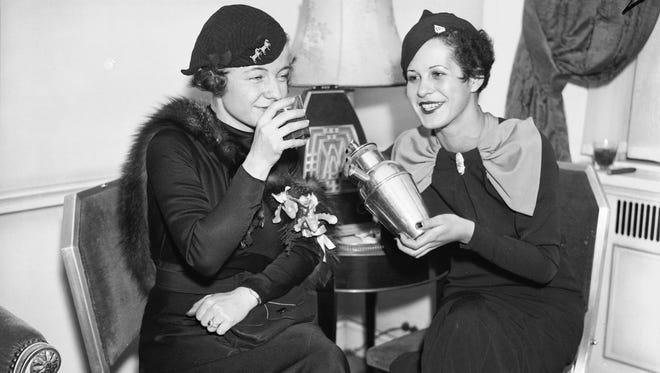 Dorothy Wentworth, right, is shown with a friend at the Waldorf-Astoria Hotel in New York City, Dec. 5, 1933 to enjoy their first legal cocktail party in many years. They will not be attending Parker's After Dark, but you should! (AP Photo)