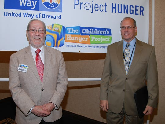 FILE PHOTO: Mark Mullins, right, with Children's Hunger Project Executive Director Bob Barnes.