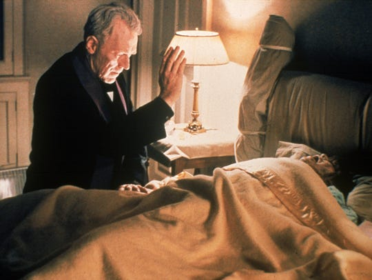 Father Merrin (Max von Sydow) tries to help a possessed