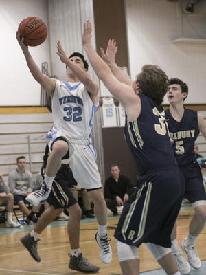 Parsippany Hills' Evan Chao drives against Roxbury's Will Findlay on Tuesday night in Parsippany.
