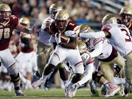 Boston College running back AJ Dillon (2) carries the ball against Florida State defensive back Derwin James (3) during the first half on an NCAA college football game in Boston, Friday, Oct. 27, 2017. (AP Photo/Michael Dwyer)