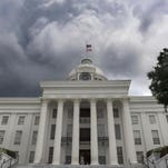 Storm clouds build over the Alabama State Capitol Building in Montgomery in this July 23 file photo.
