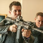 Jason Beghe, right, is a crooked cop who's back on the beat, aided by Jon Seda's Antonio Dawson.