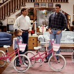"Joey (Dave Coulier, left), Danny (Bob Saget, center), and Jesse (John Stamos, right) realize they've got a big problem when they each show up with what they think is Michelle's (Mary-Kate Olsen, left) stolen bike on ""The Bicycle Thief."""