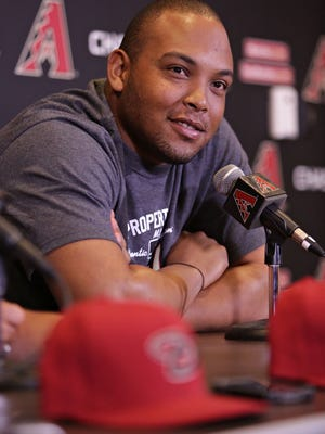 Cuban Yasmany Tomas, who signed with the Arizona Diamondbacks, answers questions through an interpreter during a press conference at the team's practice facility at Salt River Fields near Scottsdale on Thursday, Jan. 22, 2015.
