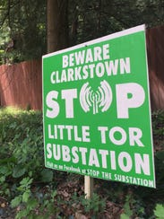 A yard sign opposing the proposed construction of a