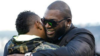 Pablo Sandoval, left, hugs David Ortiz of the Boston Red Sox before Game 1 of the World Series; now, they'll join forces with Boston to try and reach the 2015 Series.
