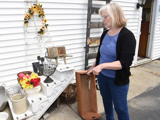 Karen Allan, owner of Pass It On 2 in Pine Plains, shows a staircase she has repurposed into a display stand.