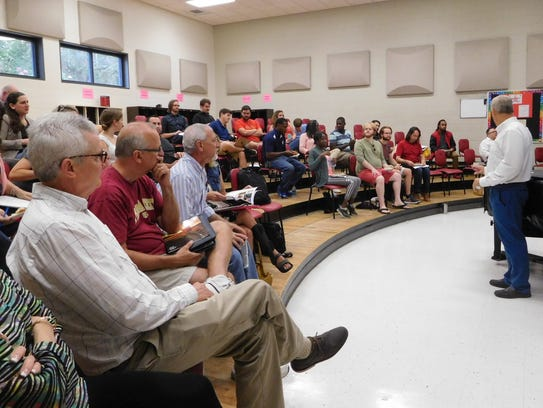Middle and high school music teachers meet to strategize