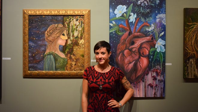 Brittany James, pictured with two of her works at Asbury Park's Art629 gallery.
