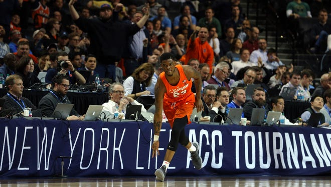 Syracuse Orange guard Frank Howard (23) reacts after a three point shot against the North Carolina Tar Heels during the first half of a second round game of the 2018 ACC tournament at Barclays Center.