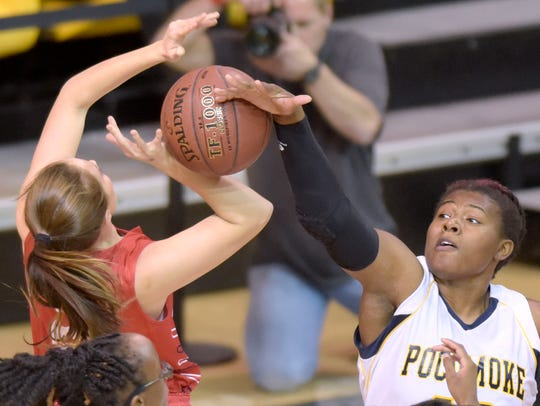 Pcomoke's Dynaisha Christian, right, blocks a shot