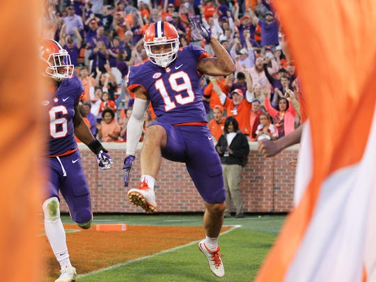 Clemson safety Tanner Muse celebrates his 64-yard interception