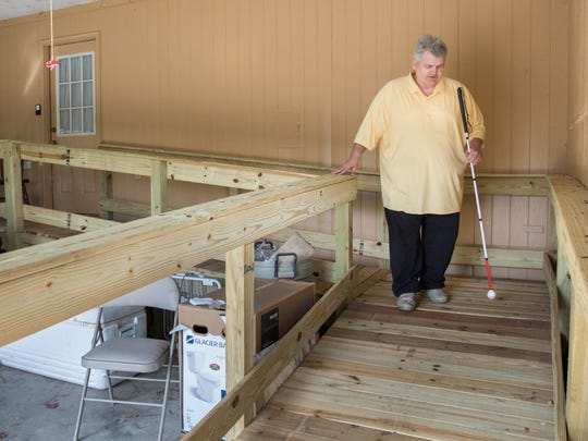 Thanks to volunteers from First Baptist Church in Jay who built a wooden ramp, Roy Allen can more easily navigate outside of his home in Jay, Florida on Friday, December 30, 2016.