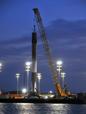 A SpaceX Falcon 9 booster has been temporarily placed at Port Canaveral's North Cargo Pier 6 area three times.