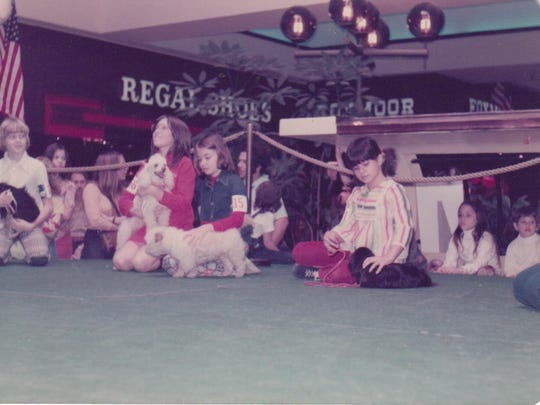 "Dena Coukoulis, 7, participates in a dog show at the Tallahassee Mall with her Pekingese pup named ""Yang."""
