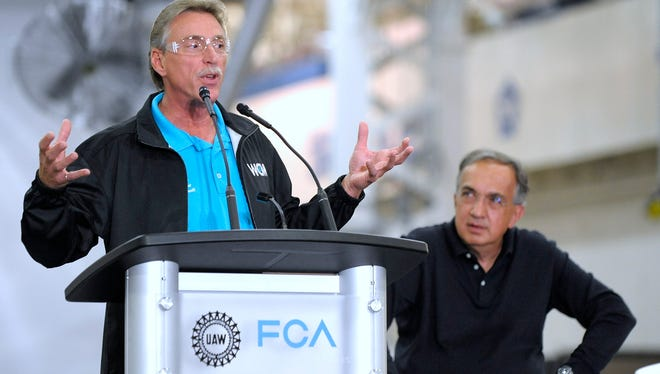 Norwood Jewell,  former UAW vice president of the FCA US Department, speaks at the Sterling Stamping Plant in 2016 as FCA CEO Sergio Marchionne listens.