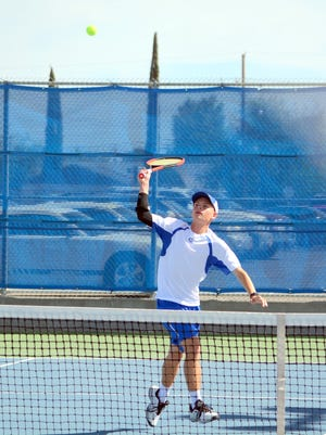 Carlsbad's Riley Nesbit gets a quick point at the net during boys doubles play Tuesday against Gadsden.