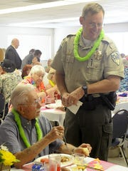 Sheriff Al McNeil talks with people during lunch.