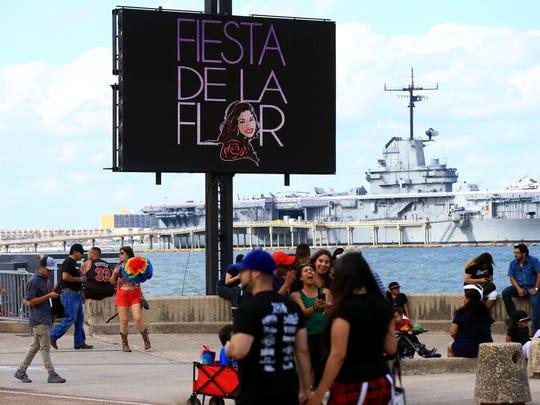 People attend the second day of Fiesta de la Flor on