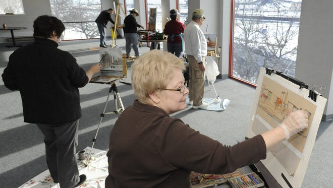 Waters Edge Artists worked with art students at Silver Lake College and will host a showing of their nature-themed artwork at the college, with the show opening April 3. A reception is planned for April 20. Pictured, Water's Edge artists at the Wisconsin Maritime Museum in 2011.