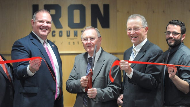 Iron County Commissioner Dale Brinkerhoff cuts the ribbon at the open house of the Iron County Courthouse Monday, February 12, 2018.