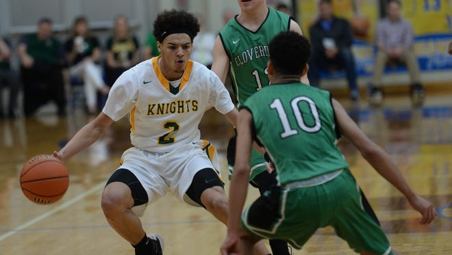 Northeastern's Tyler Smith drives to the basket against Cloverdale during Saturday's Class 2A regional semifinal at Greenfield-Central.