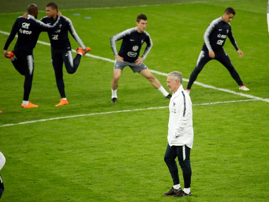 France's head coach Didier Deschamps attends a training session of his team on the eve of a friendly soccer match between Russia and France, at the Saint Petersburg stadium in St.Petersburg, Russia, Monday, March 26, 2018. (AP Photo/Dmitri Lovetsky)