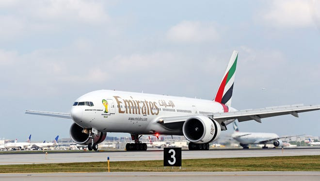 In this file photo from August 2014, an Emirates airline Boeing 777-200LR touches down at O'Hare International Airport for the carrier's inaugural flight into Chicago.